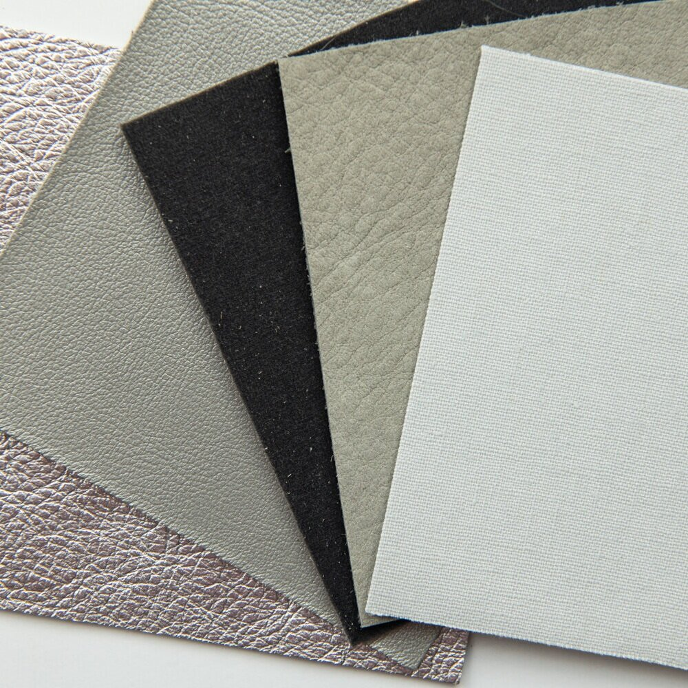 THERE ARE SO MANY COVER OPTIONS FOR YOUR ALBUM. YOU CAN CHOOSE FROM METALLIC, PEARL LEATHER, VELVET, SUEDE, AND LINEN. HERE IS A SAMPLE OF GRAYS IN THE DIFFERENT TEXTURES.